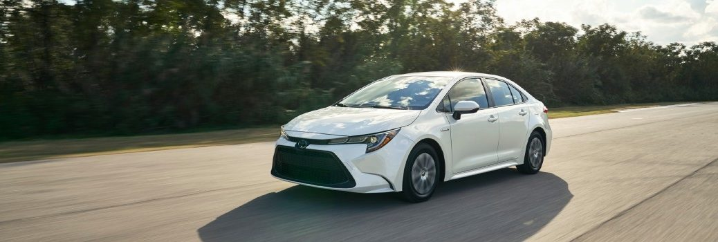 2020 Toyota Corolla driving down the street