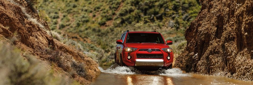 red 2020 Toyota 4Runner driving through the water