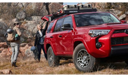 2020 Toyota 4Runner red with hikers and bikes on top rack