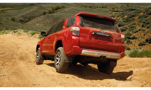 2020 Toyota 4Runner red driving through dry grasses