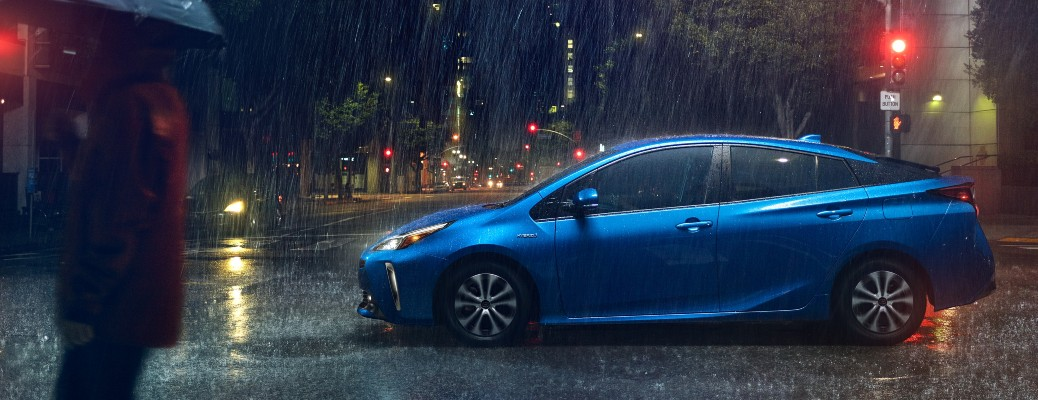 2020 Toyota Prius blue driving to the right in rainfall