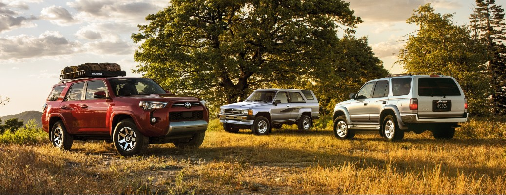 2020 Toyota 4Runner 3 colors parked in grass with trees and sky in background