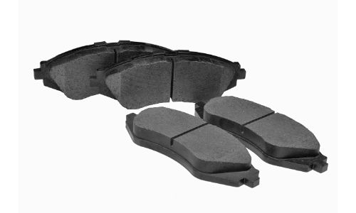 stock photo of brake pads four on white background