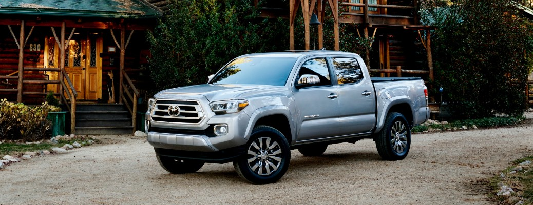 2021 Toyota Tacoma silver parked in front of cabin