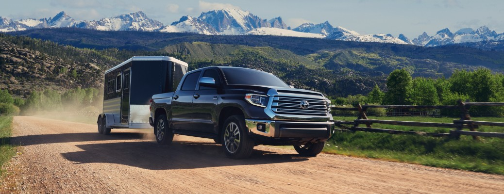 2021 Toyota Tundra black pulling large trailer view of mountains