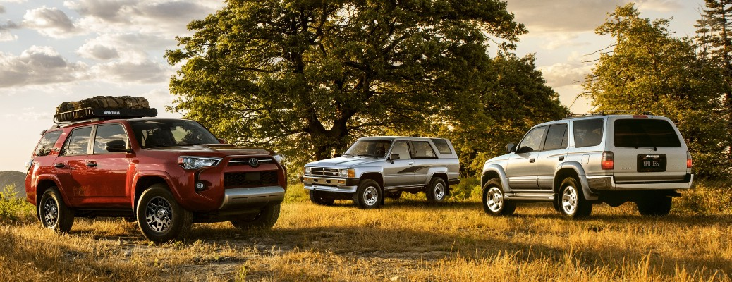 2021 Toyota 4Runner red, silver, and white parked on dry grass