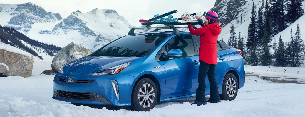 2021 Toyota Prius Blue in snow with snowboards