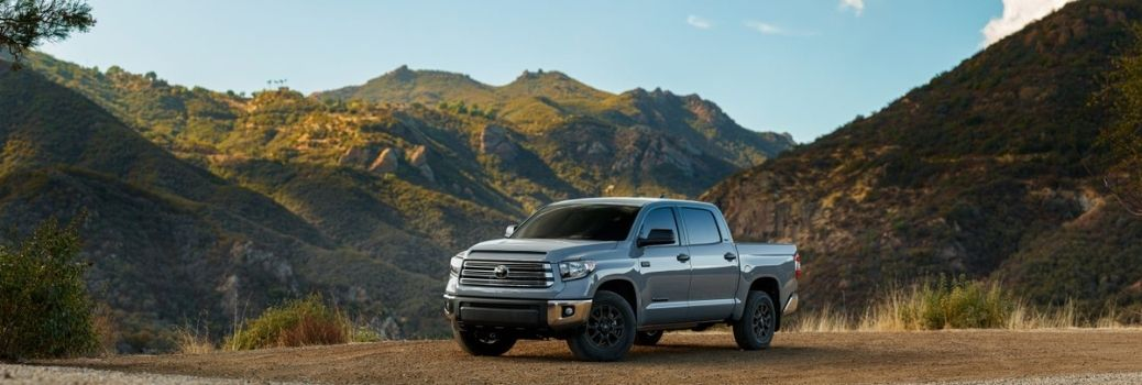 2021 Toyota Tundra parked in a countryside with mountains in the background