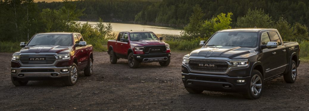 Three 2020 Ram 1500 EcoDiesel trucks parked near a river