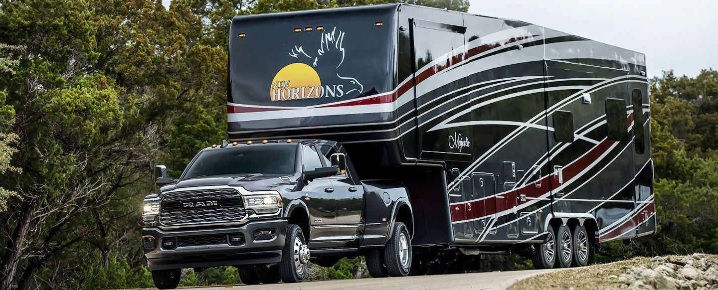 Black 2019 Ram Heavy Duty towing a black RV