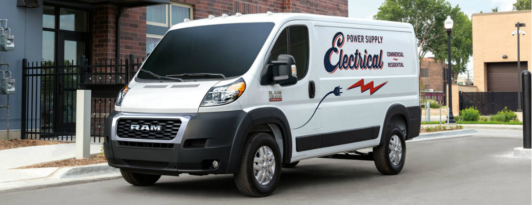 White 2020 Ram ProMaster parked next to a brick building