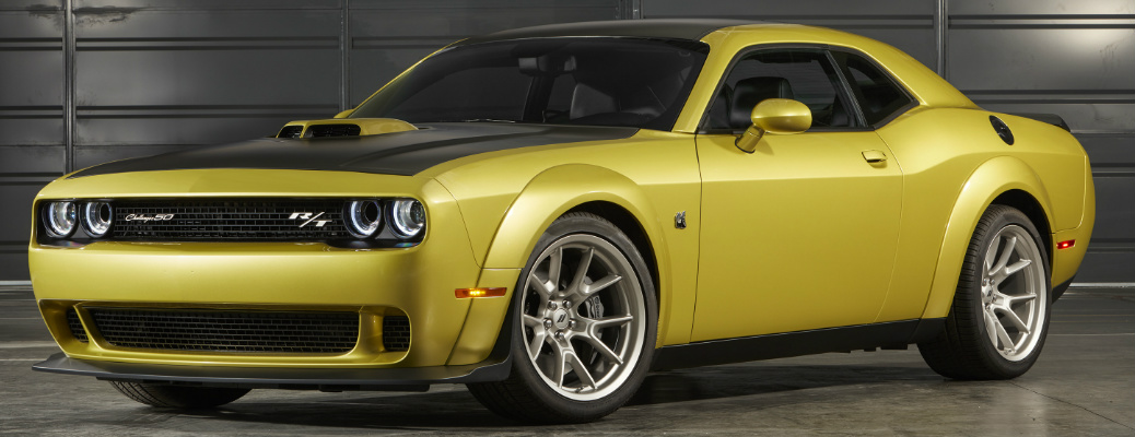 Driver's side front angle view of yellow and black 2020 Dodge Challenger