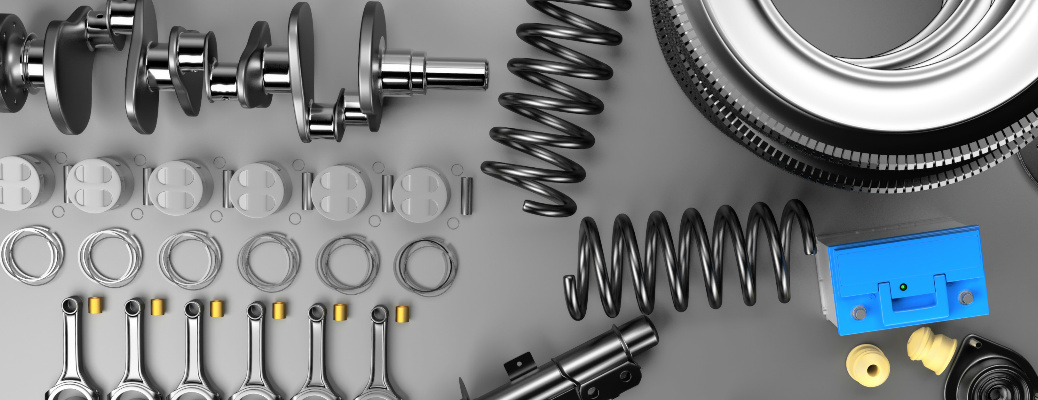 Various automotive parts with a gray background