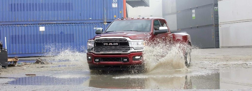 2021 Ram 3500 red exterior front fascia driving through puddle outside of warehouse