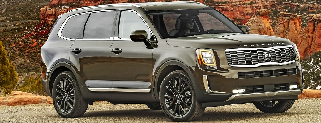 Passenger's side front angle view of green 2020 Kia Telluride
