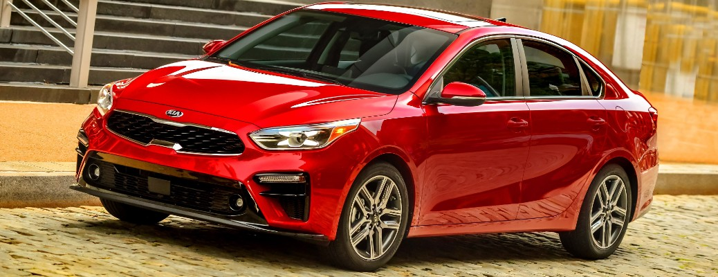 Driver's side front angle view of red 2021 Kia Forte