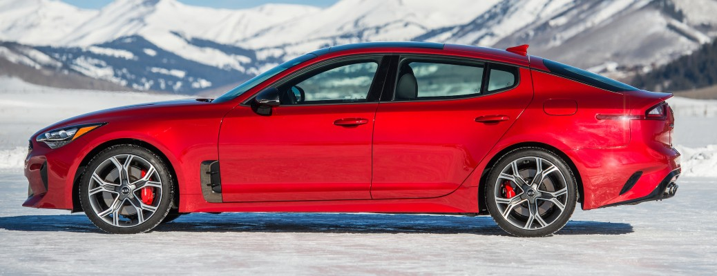 2021 Kia Stinger GT2 RWD exterior side shot with HiChroma Red paint color parked in the icy tundra