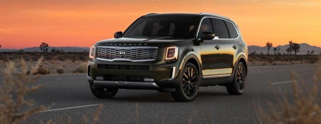 2021 Kia Telluride Nightfall Edition driving with a sunset background.