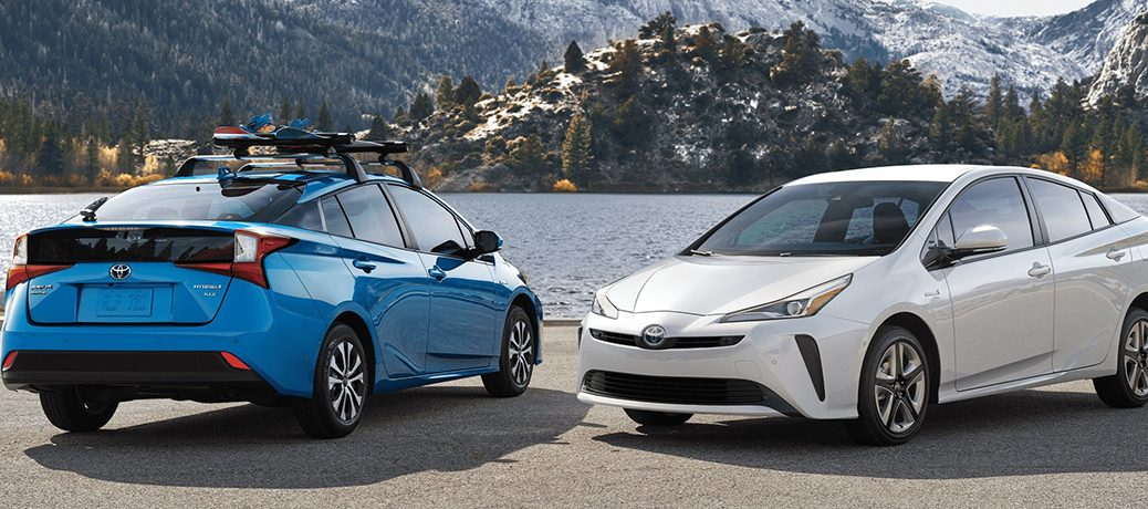 Two 2020 Toyota Prius hybrids parked next to each other