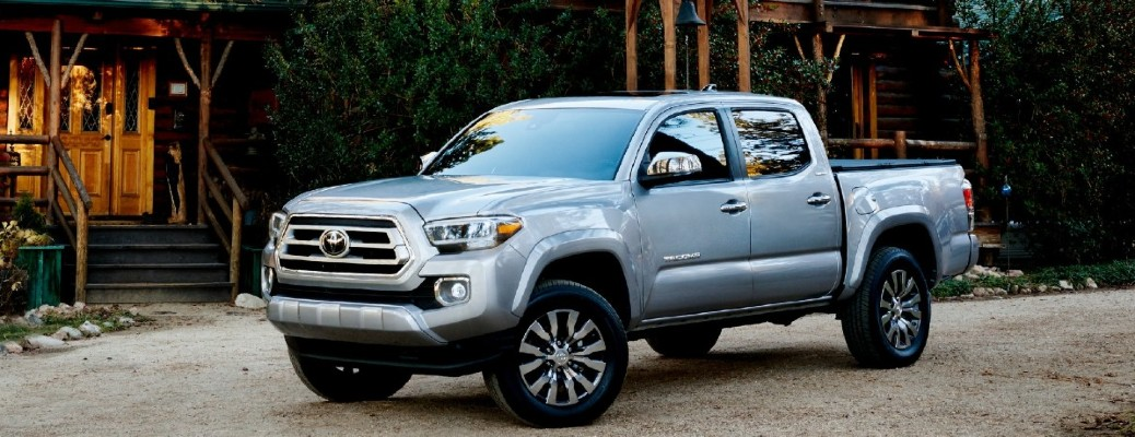 2021 Toyota Tacoma silver exterior front fascia driver side parked on gravel driveway in front of cabin