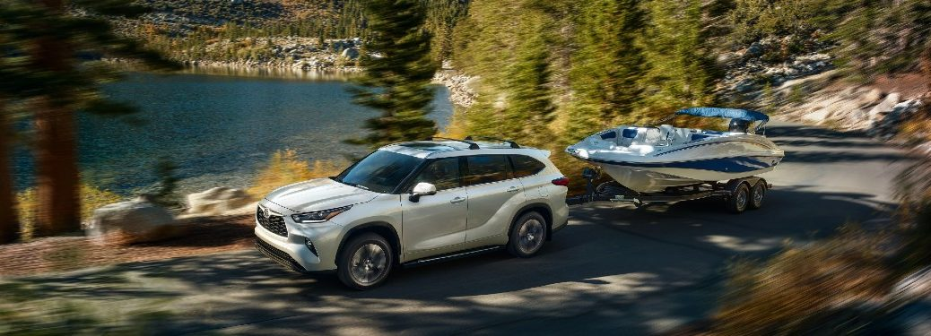 2021 Highlander white exterior towing boat in forest lake area