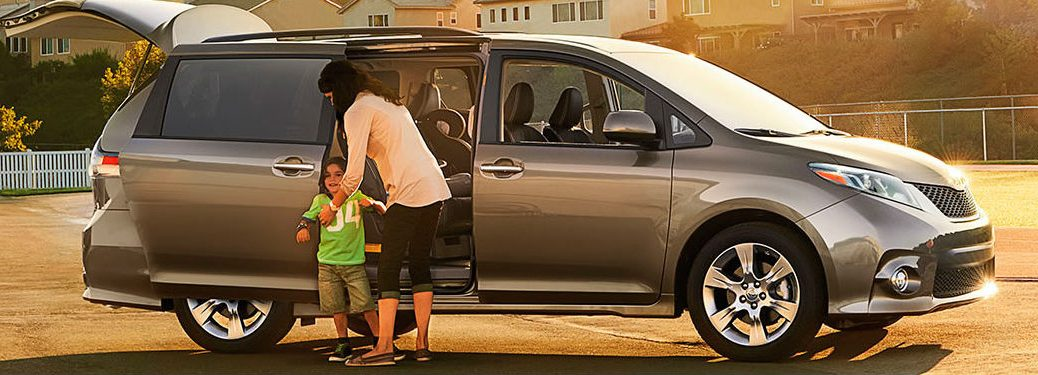 Mom and child standing outside the 2018 Toyota Sienna