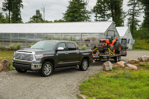 2017 Toyota Tundra towing a tractor