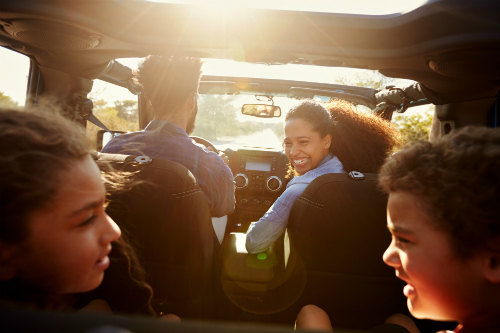 family smiling in the car
