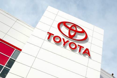 Toyota logo on car dealership wall