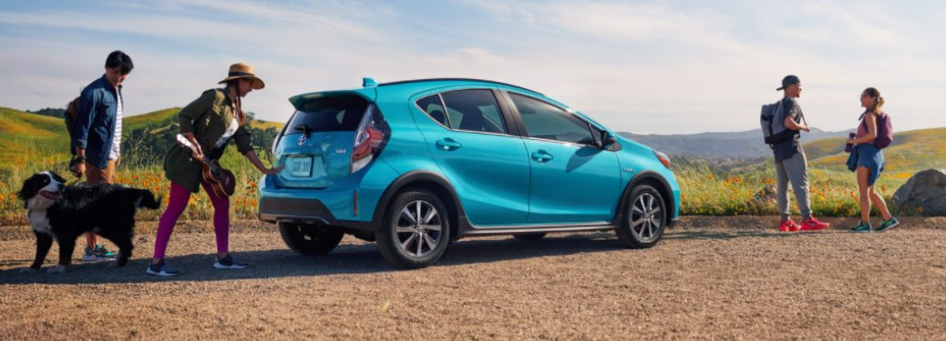 2018 Prius c parked near hikers