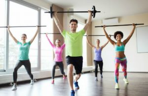 People lifting weights in a group fitness class