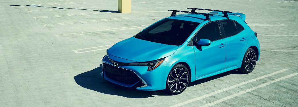 2019 Toyota Corolla Hatchback in bright blue sitting in an empty parking lot