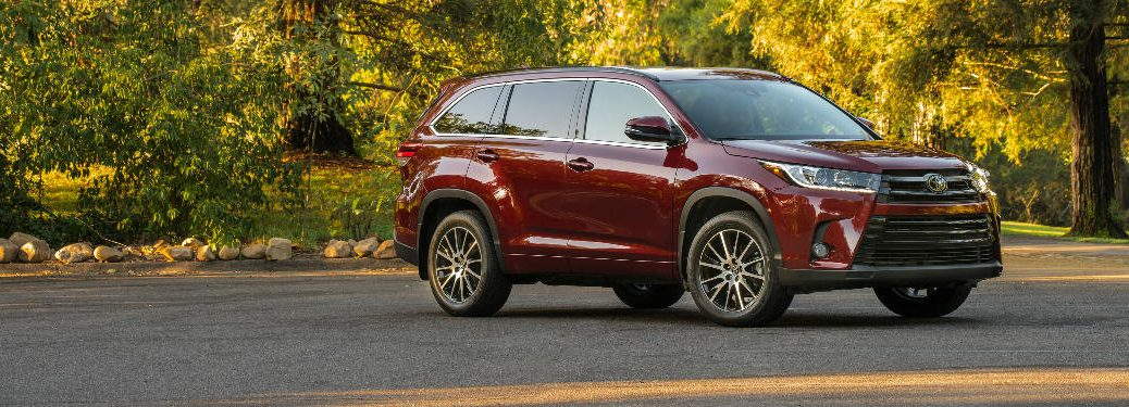 2018 Toyota Highlander parked in a paved lot in the woods