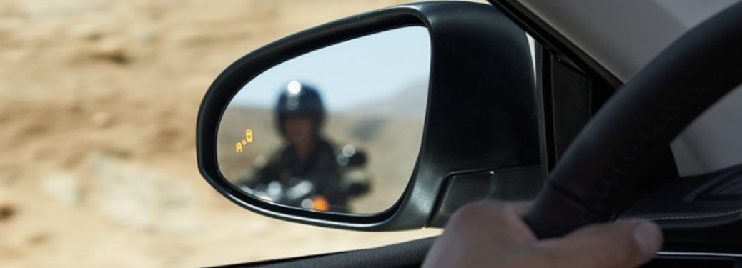 Side mirror with Toyota Blind Spot Monitor warning light