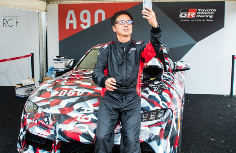 Tetsuya Tada taking a selfie with the Toyota Supra prototype