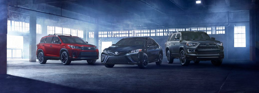 2019 Toyota Nightshade Edition Camry, Highlander, and 4Runner models lined up in a parking garage