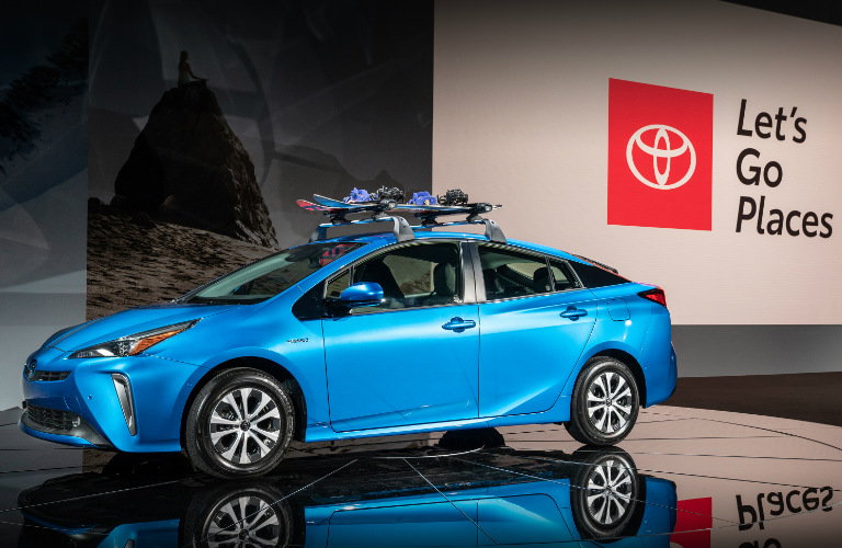 2019 Toyota Prius with a roof rack parked on a stage