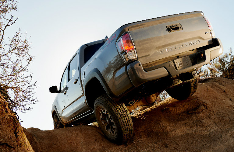 2020  Toyota Tacoma climbing over a large rock