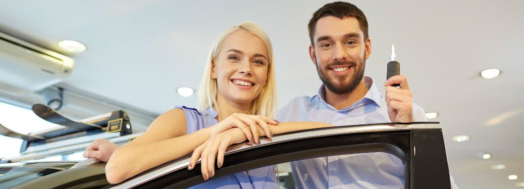 Couple with keys to a new car