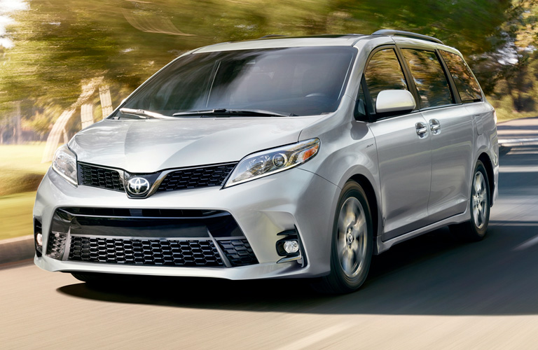 2019 Toyota Sienna driving on a residential street