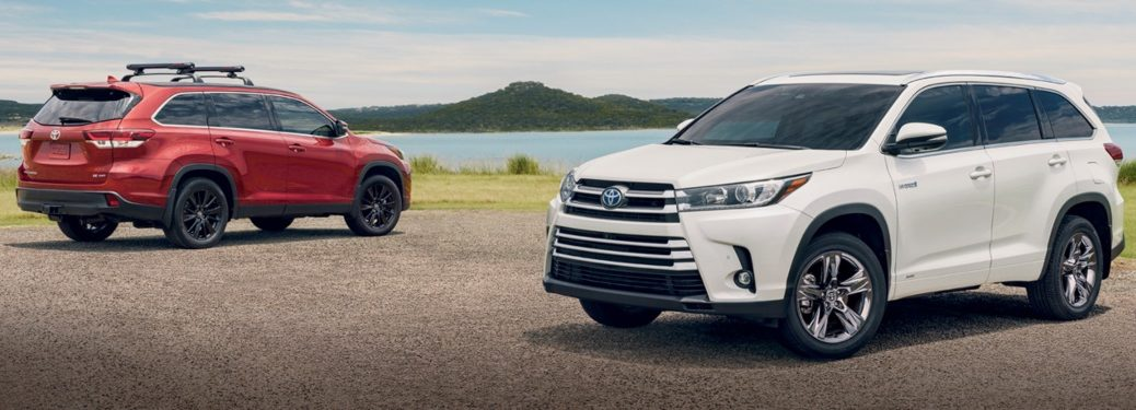 Two 2019 Toyota Highlander Vehicles sitting by water