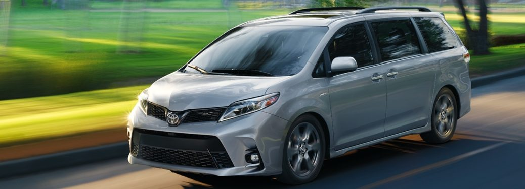 2020 Toyota Sienna cruising past green grass