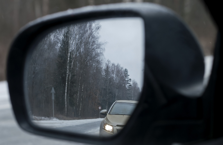 Sedan in Rear View Mirror
