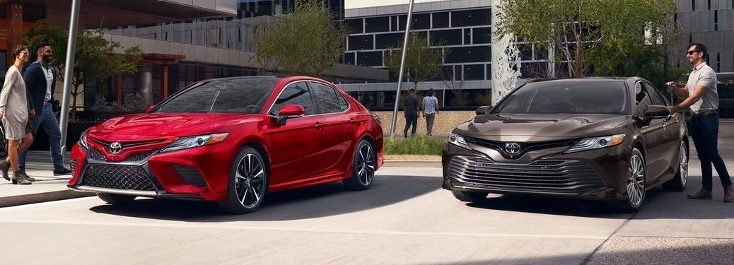 2020 Toyota Camry cars parked on front of building