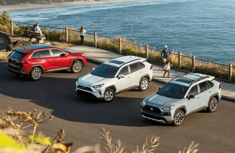 2020 Toyota RAV4 crossovers parked next to water