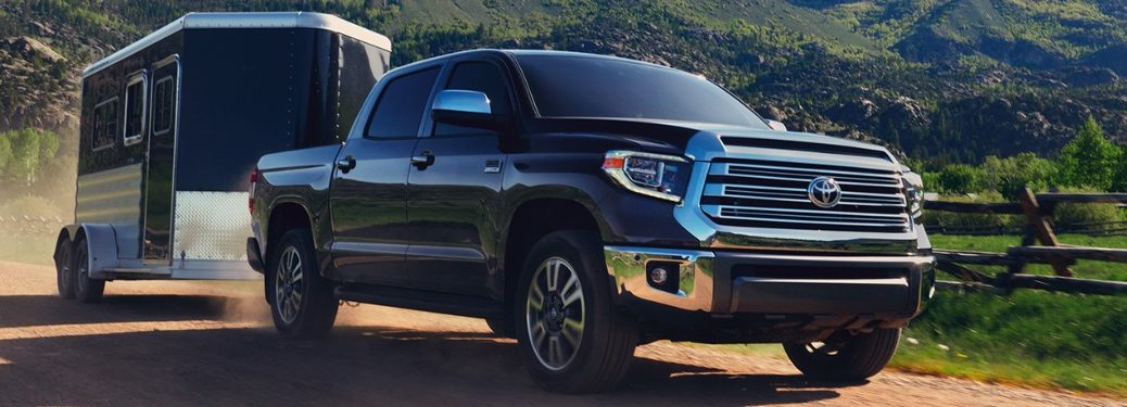 2020 Toyota Tundra pulling a trailer down the road