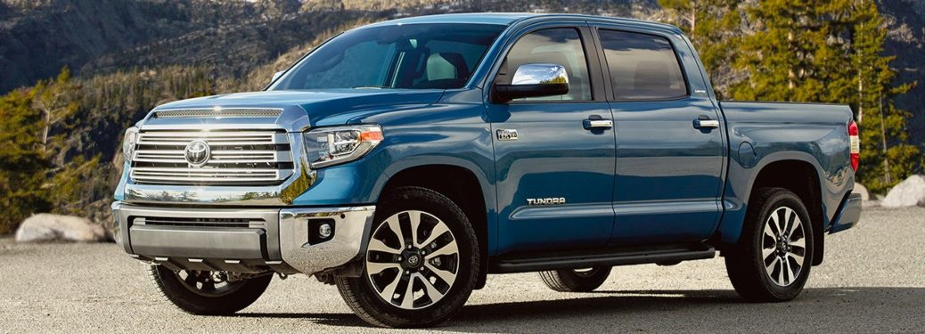 2020 Toyota Tundra parked with green trees behind it