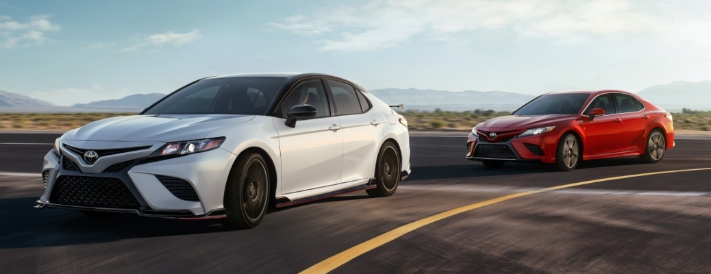 2020 Toyota Camry sedans going around a curve