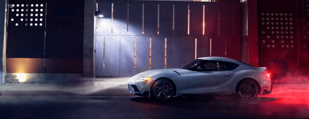 2021 Toyota GR Supra going down a dark street