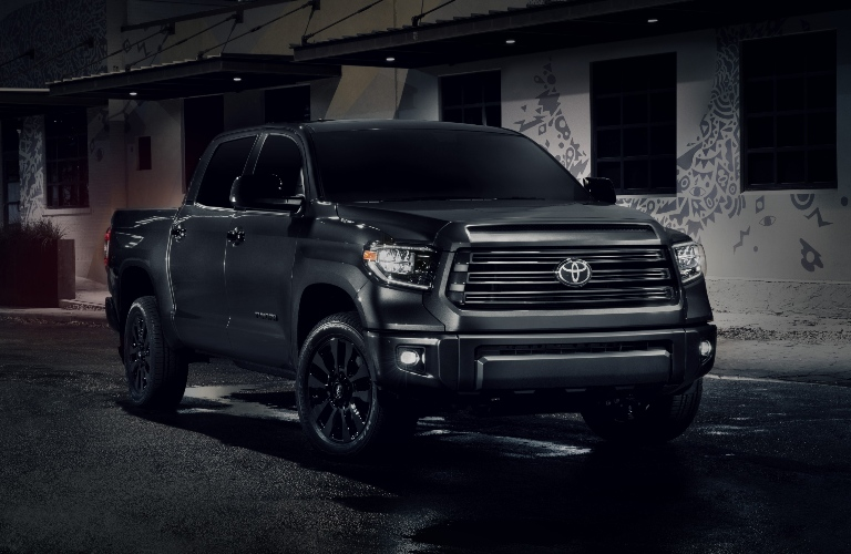 2021 Toyota Tundra Nightshade Edition parked in front of a house